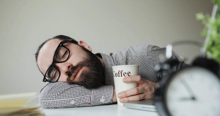sleeping man w coffee