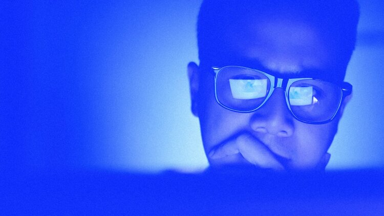 anxious man w glasses
